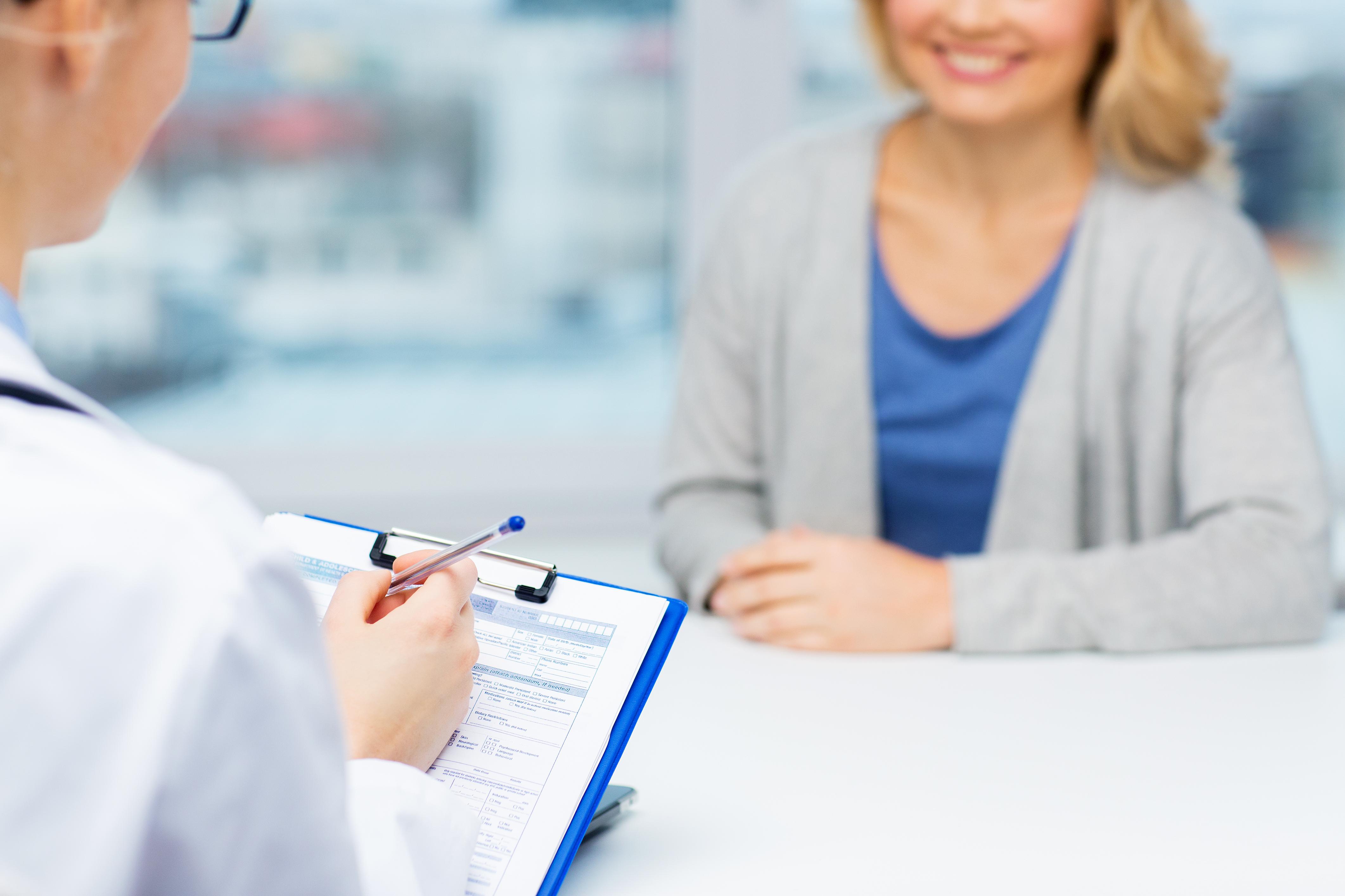 podiatrist with patient